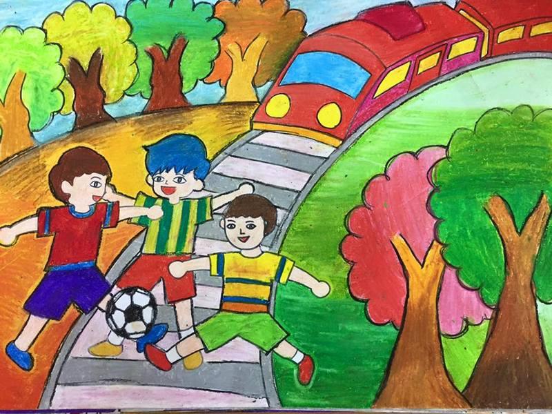 tranh vẽ nhắc nhở các bạn học sinh không được đá bóng trên đường sắt