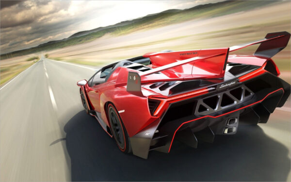 hình nền Lamborghini màu đỏ đang chạy trên đường